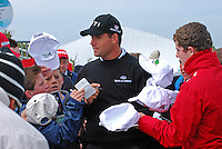 Padraig Harrington, professional golfer, Rep of Ireland, surrounded by young fans on the 1st tee. 200905132423..Taken at the Irish Open Pro-Am Day, Wednesday 13 May 2009, at Baltray. Like most  participants he was dressed for warmth because of the chill easterly breeze coming off the Irish Sea.<br />
