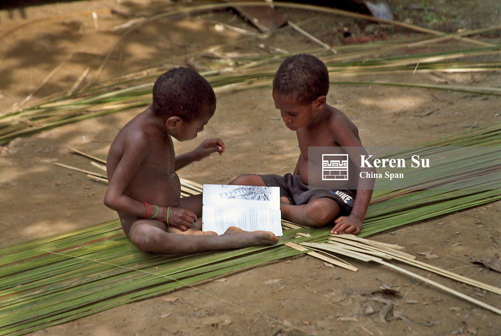 Sepik River children weaving reed sheet, Upper Sepik river, Papua New Guinea