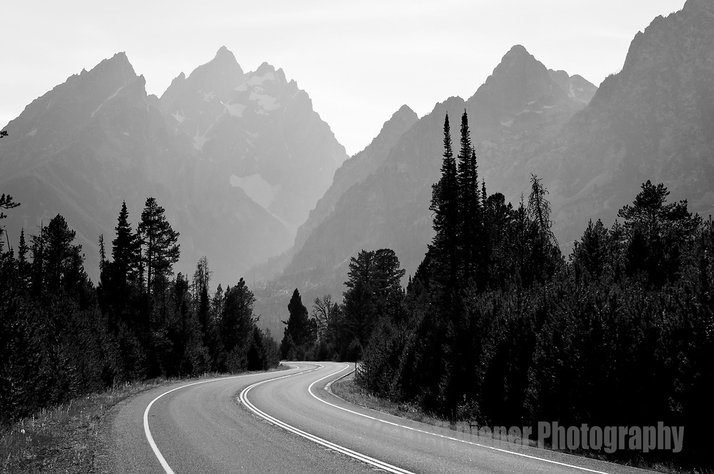 A road winds through Grand Teton National Park In Jackson Hole, Wyoming.