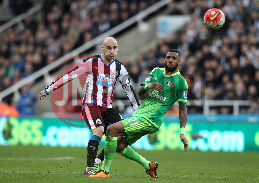 Jonjo Shelvey of Newcastle United chips the ball forward over Yann M'Vila of Sunderland - Mandatory byline: Robbie Stephenson/JMP - 20/03/2016 - FOOTBALL - ST James Park - Newcastle, England - Newcastle United v Sunderland - Barclays Premier League
