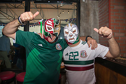 July 2, 2018 - FL, USA - Mexico fans wearing wrestling masks Javier Ortega, left, and Mario Reyes pose for picture during a FIFA World Cup Round of 16 knockout stage watch party featuring Brazil versus Mexico at Vares in Brickell on Monday, July 2, 2018. (Credit Image: © Sam Navarro/TNS via ZUMA Wire)