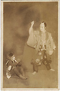 Kabuki actors with child in a monkey costume, 1920s, silver gelatin bromide post card. <br />