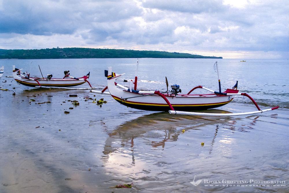 Bali, Badung, Jimbaran. Traditional boats ready to go to sea for the nights fishing.
