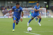 Andy Barcham of AFC Wimbledon runs with the ball while Lyle Taylor of AFC Wimbledon looks on during the Sky Bet League 2 match between AFC Wimbledon and Plymouth Argyle at the Cherry Red Records Stadium, Kingston, England on 8 August 2015. Photo by Stuart Butcher.