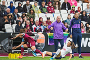 Juan Amoras, Head Coach of Tottenham Hotspur Borough FC looks shocked as players fall in front of him during the FA Women's Super League match between West Ham United Women and Tottenham Hotspur Women at the London Stadium, London, England on 29 September 2019.