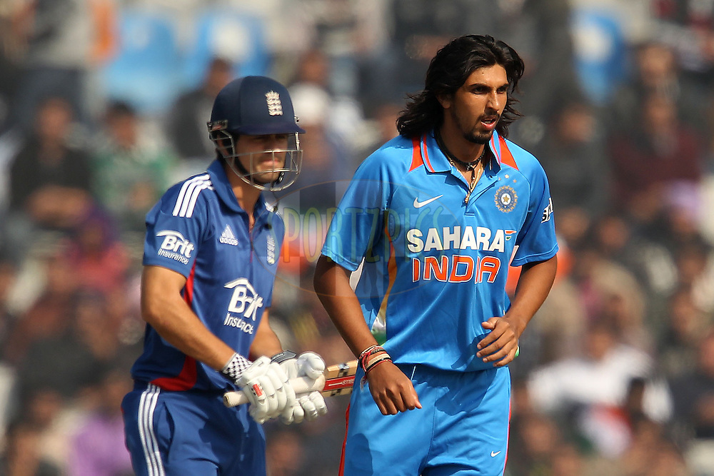 Ishant Sharma of India walks back after bowling to Alastair Cook of England during the 4th Airtel ODI Match between India and England held at the PCA Stadium, Mohal, India on the 23rd January 2013..Photo by Ron Gaunt/BCCI/SPORTZPICS ..Use of this image is subject to the terms and conditions as outlined by the BCCI. These terms can be found by following this link:..http://www.sportzpics.co.za/image/I0000SoRagM2cIEc