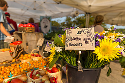The Barker's Farm booth at the Portsmouth, New Hampshire Farmer's Market.