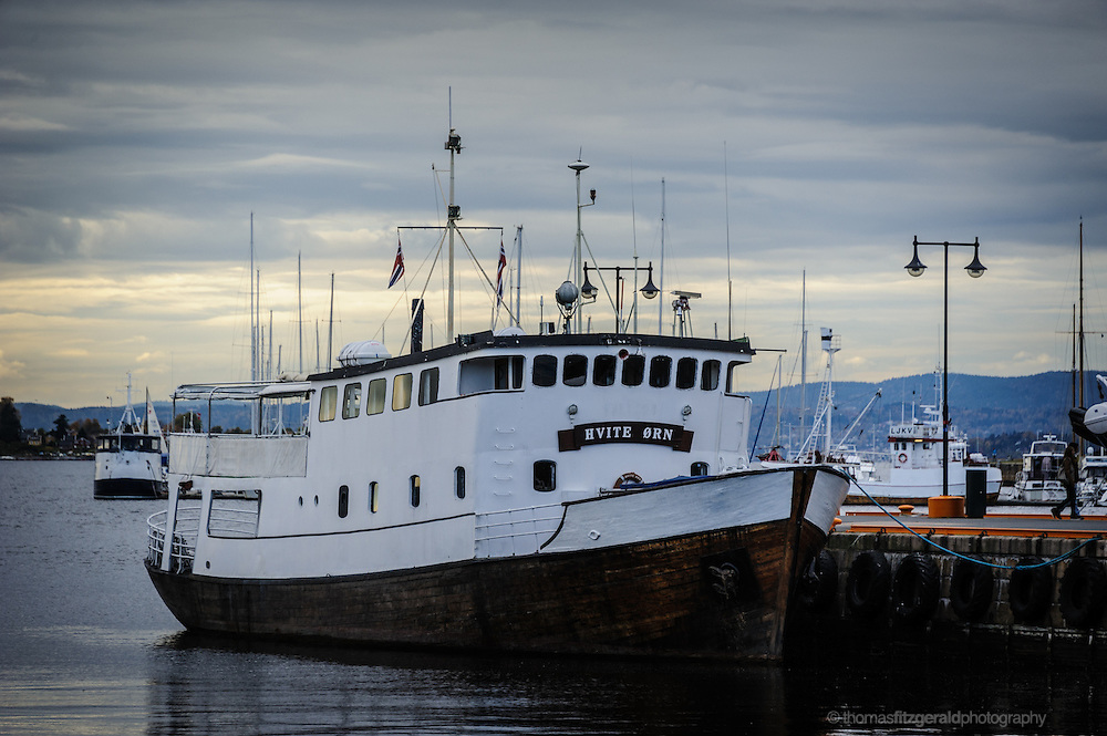 Oslo, Norway, October 2012: A curvy boat docked in the oslo harbour