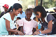 203, Sandra Vavivola, Female, 12 years old, UCL, before. Drawing with Translators Ando Ramarokoto and Patricia Boara Saida whilst waiting for screening.<br /> <br /> Hospital Joseph Ravoahangy Andrianavalona.  Operation Smile's 2015 mission to Antananarivo - Madagascar. 10th -18th April 2015.<br /> <br /> (Operation Smile Photo - Zute Lightfoot)