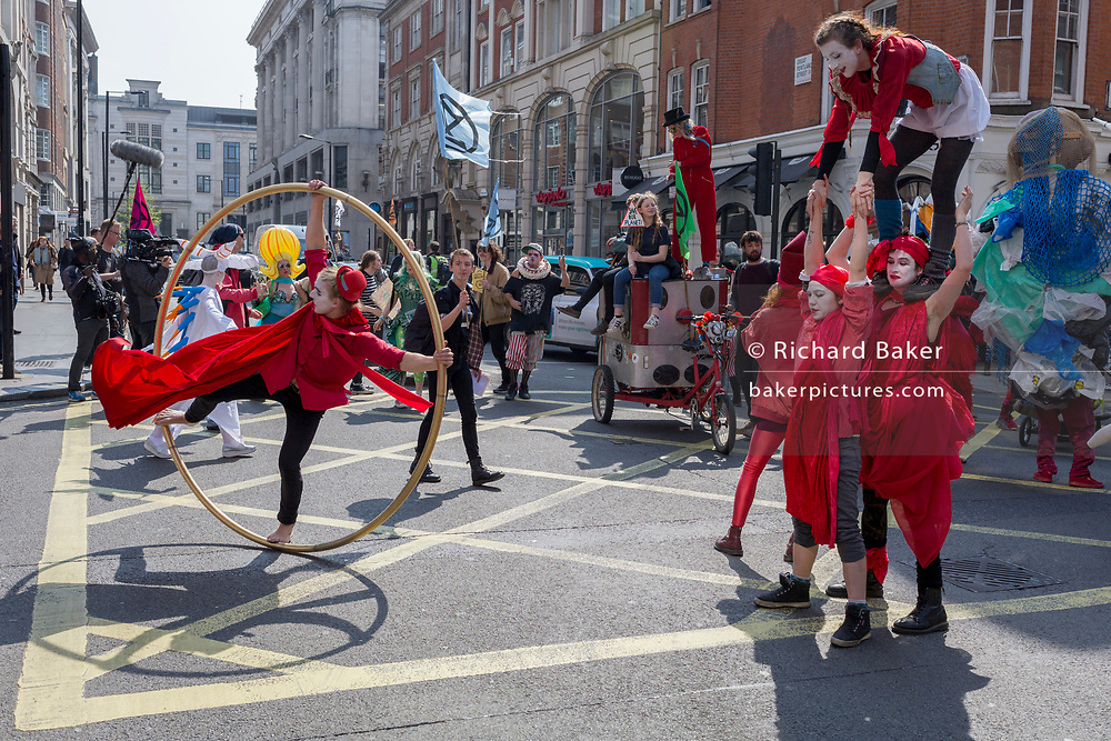 Climate Change protestors with Extinction Rebellion block central London and simultaneously stop traffic across the capital including Marble Arch, Piccadilly Circus, Waterloo Bridge and roads around Parliament Square, on 15th April 2019, in London, England.