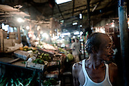 A tamil man sells produce in a market in Colombo, Sri Lanka, July 2, 2009. With the end of the 26 war between the Sri Lankan government and the LTTE, security in the capital city remains on high alert.