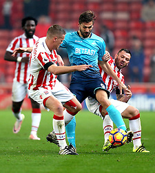 Fernando Llorente of Swansea City battles for the ball with Ryan Shawcross and Phillip Bardsley of Stoke City of Stoke City - Mandatory by-line: Robbie Stephenson/JMP - 31/10/2016 - FOOTBALL - Bet365 Stadium - Stoke-on-Trent, England - Stoke City v Swansea City - Premier League