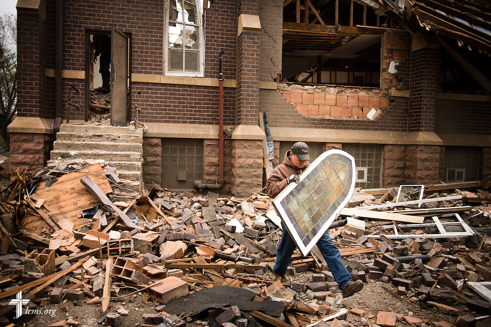Jim Kaufman carries stained glass from the rubble of Zion Lutheran Church on Monday, May 11, 2015, in Delmont, S.D. A tornado swept through the area the previous day and destroyed the church and nearby buildings. LCMS Communications/Erik M. Lunsford