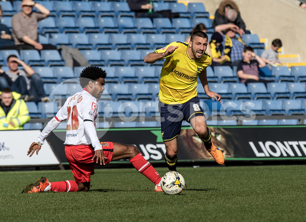 Liam Sercombe of Oxford United skips past Bradley Pritchard of Stevenage during the Sky Bet League 2 match between Oxford United and Stevenage at the Kassam Stadium, Oxford, England on the 25th March 2016. Photo by Liam McAvoy.