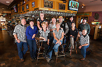 "Returning Team members with the ""official"" referrees get prepped for the Pub Mania event at Patrick's Pub and Eatery to benefit the Children's Auction to begin on December 8th.  (l-r Shawn Bailey, Marcia Wadsworth, Lucy Jacobson, Jennifer Beetle, Jennifer Bailey, Tony Felch, Randy Remick, Matt Resca, Ashley Riopel, Keith McBey and Allan Beetle).  (Karen Bobotas/for the Laconia Daily Sun)"