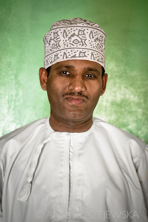 Oman, Al-Hamra. Portrait of an Omani man wearing a typical Omani hat.