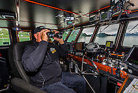 Ship's captain on the bridge, Wilderness Explorer (small cruise ship), Glacier Bay National Park (a UNESCO World Heritage Site), Alaska USA.