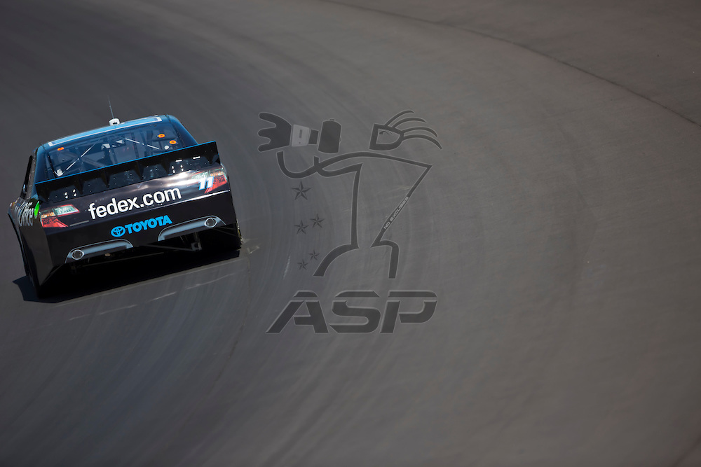 BROOKLYN, MI - JUN 14, 2012:  Denny Hamlin (11) brings his car through the turns during the second test session for the Quicken Loans 400 at the Michigan International Speedway in Brooklyn, MI.
