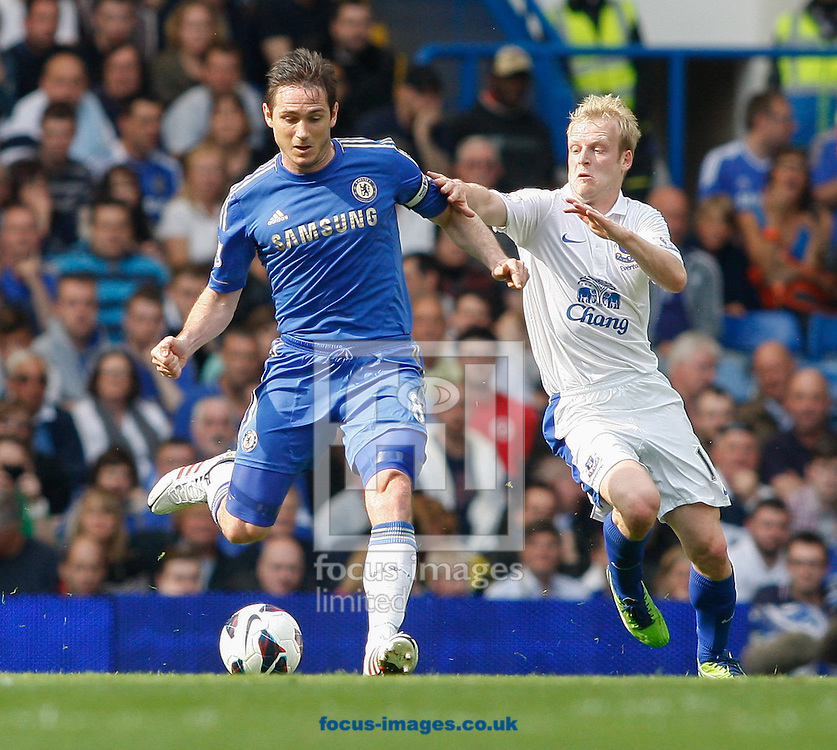 Picture by Andrew Tobin/Focus Images Ltd +44 7710 761829.19/05/2013. Frank Lampard of Chelsea (L) is challenged by Steven Naismith of Everton during the Barclays Premier League match at Stamford Bridge, London.