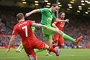 Sunderland defender John O'Shea clears the ball ahead of Liverpool midfielder James Milner   during the Barclays Premier League match between Liverpool and Sunderland at Anfield, Liverpool, England on 6 February 2016. Photo by Simon Davies.