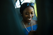 TUSCALOOSA, AL – SEPTEMBER 28, 2016: Tamia Oakley, 15, rides a bus alongside other prospective students toward freshman housing at the University of Alabama. As a high school sophomore in Suwanee, Georgia, Tamia is touring the university alongside her sister, Taylor Oakley, who hopes to attend as a law and philosophy major in the fall of 2017. Despite the rising cost of college tuition nationwide, in state student enrollment is becoming less profitable for major public universities. In response to these financial shortfalls, flagship universities around the country are working hard to rebrand themselves as attractive institutions for out of state students. The University of Alabama has begun an aggressive campaign to recruit out of state students, as the revenue from those students is much greater. CREDIT: Bob Miller for The New York Times