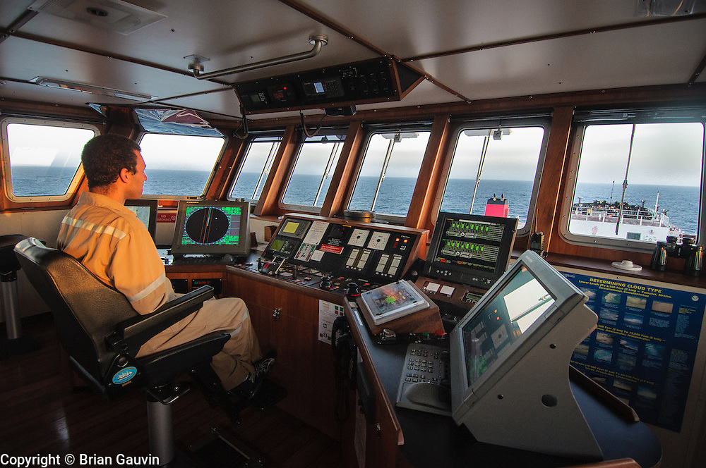 2nd mate, Dave Cunningham on the bridge of Legacy. ATB, Legacy and barge 750-1, Crowley Maritime. Transporting primium and regular grade gasoline from Marathon Oil in Garryville, La. to Port Everglades and Tampa Florida.