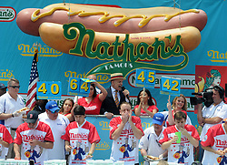 Joey Chestnut (C) competes during the men's competition of the Nathan's Hot Dog Eating Contest at Coney Island of New York City, NY, USA, on July 4, 2018. Joey Chestnut set a new world record Wednesday by devouring 74 hot dogs in 10 minutes at the Nathan's Hot Dog Eating Contest in New York. Miki Sudo defended the women's title by eating 37 hot dogs in 10 minutes. Photo by Dennis Van Tine/ABACAPRESS.COM