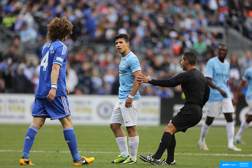 David Luiz, Chelsea and Sergio Aguero, Manchester City, are kept apart during the Manchester City V Chelsea friendly exhibition match at Yankee Stadium, The Bronx, New York. Manchester City won the match 5-3. New York. USA. 25th May 2012. Photo Tim Clayton