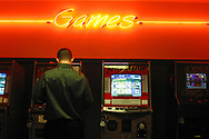 Cary Snyder stands in front of a row of touch screen video games at Flying J's in Hubbard, OH. The local government is debating on whether or not these games are legal in the state where gambling on games of chance is prohibited.