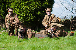 Renactors portraying the Cheshire Regiment of the first world war undertake training behind the Elm Tree Pub before they take part in a reenactment in Elmton in June..Ed Wilson gives covering fire with his Lee Enfield Rifle while Peter Austeridge and Stuart Oden-Walder (right) change the drum magazine on a Lewis machine gun....20 April  2013.Image © Paul David Drabble
