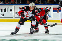 KELOWNA, BC - NOVEMBER 1: Brendan Boyle #14 of the Prince George Cougars wins the face-off against Kyle Crosbie #18 of the Kelowna Rockets  at Prospera Place on November 1, 2019 in Kelowna, Canada. (Photo by Marissa Baecker/Shoot the Breeze)