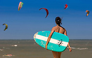 Reportage for Paris Match Belgium<br /> <br /> A surfer watches kitesurfers fly through the air over the waters of the North Sea. (Photo &copy; Jock Fistick)