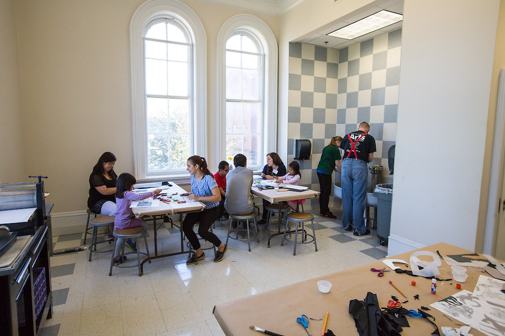 Families enjoy the day at the Sunday Family Art Encounters at the Kennedy Museum of Art on Sunday, Sept. 15, 2014.