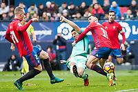 FC Barcelona's Luis Suarez , Club Atletico Osasuna's Ivan Marquez during the match of La Liga between Club Atletico Osasuna and Futbol Club Barcelona at Sadar Stadium in Pamplnoa , Spain. December 10, 2016. (ALTERPHOTOS/Rodrigo Jimenez)