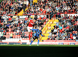 Bristol City's Derrick Williams battles for the high ball with Swindon Town's Alex Pritchard - Photo mandatory by-line: Joe Meredith/JMP - Mobile: 07966 386802 15/03/2014 - SPORT - FOOTBALL - Bristol - Ashton Gate - Bristol City v Swindon Town - Sky Bet League One