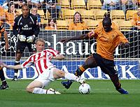 Photo: Dave Linney.<br />Wolverhampton Wanderers v Stoke City. Coca Cola Championship. 23/09/2006Stoke's .Luke Chadwick(L) gets a foot on the ball before  Seyi Olofinjana