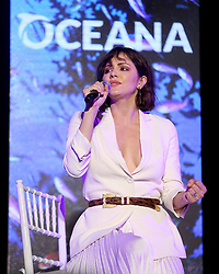 """**EXCLUSIVE** Date: July 21st 2018 Katherine McPhee shows off her huge engagement ring as she performs at the Oceana SeaChange Summer Party in Laguna Niguel,CA. The actress opened up to the crowd saying she was """"very happy in her relationship"""" before singing 'Over The Rainbow' mentioning that she met her now fiancee, David Foster, for the first time when he produced a version of the famous song for her. 21 Jul 2018 Pictured: Katherine McPhee. Photo credit: MOVI Inc. / MEGA TheMegaAgency.com +1 888 505 6342"""