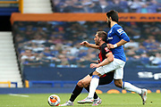 Everton midfielder Andre Gomes (21) tackles Bournemouth midfielder Dan Gosling (4) during the Premier League match between Everton and Bournemouth at Goodison Park, Liverpool, England on 26 July 2020.