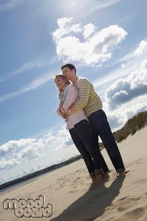 Couple embracing on beach