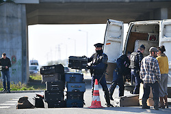 © Licensed to London News Pictures. 23/10/2016. Calais, France. Empty suitcases being unloaded by French police at the entrance to the camp, as preparations begin for the demolition of the migrant camp in Calais, France, known as the 'Jungle'. French authorities have given an eviction order to thousands of refugees and migrants living at the makeshift living area of the French coast. Photo credit: Ben Cawthra/LNP