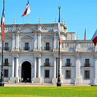 """La Moneda Presidential Palace in Santiago, Chile<br /> This was Chile's national royal mint when it opened in 1805. La Moneda means """"the coin.""""  Forty years later, the building was converted into the president's residence. Today, it serves as the offices for the president and several cabinet ministries. The grassy area is called Plaza de la Constitucíon. The commons was added during the 1930s. The Neoclassical style of Palacio de La Moneda was designed by Joaquín Toesca. He was a prolific architect who served the Spaniards in Santiago during the second half of the 18th century."""