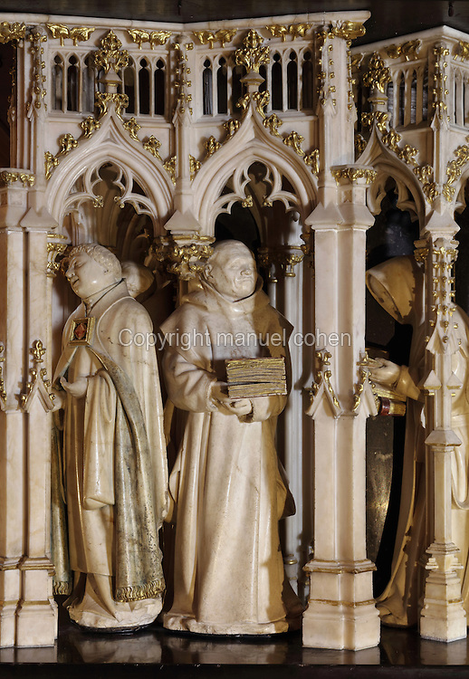 Sculptures of weepers under Gothic canopies by Claus Sluter, 1340-1405, and Claus de Werve, 1380-1459, on the tomb of Philippe le Hardi, or Philip the Bold, 1342-1404, (Philippe II, duc de Bourgogne, or Philip II, Duke of Burgundy), 1381-1410, in the Grande Salle du Palais des ducs de Bourgogne, or Salle des Gardes, a 15th century Flamboyant Gothic hall, in the Musee des Beaux-Arts de Dijon, opened 1787 in the Palace of the Dukes of Burgundy in Dijon, Burgundy, France. The tomb consists of a painted alabaster effigy with lion and angels, and below, figures of pleurants or weepers among Gothic tracery. Claus Sluter worked on the weepers 1389-1404 and produced startlingly realistic sculptures, and Claus de Werve completed them 1404-10. The tombs were originally from the Chartreuse de Champmol, or Chartreuse de la Sainte-Trinite de Champmol, a Carthusian monastery which was sacked in the French Revolution and the tombs moved to Dijon cathedral then here in 1827. Picture by Manuel Cohen