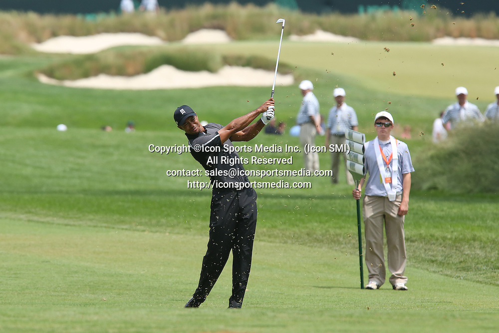 June 11 2013: Tiger Woods hits an iron from the fairway during tuesday's practice round at the 2013 U.S. Open hosted by Merion Golf Club in Ardmore, PA.