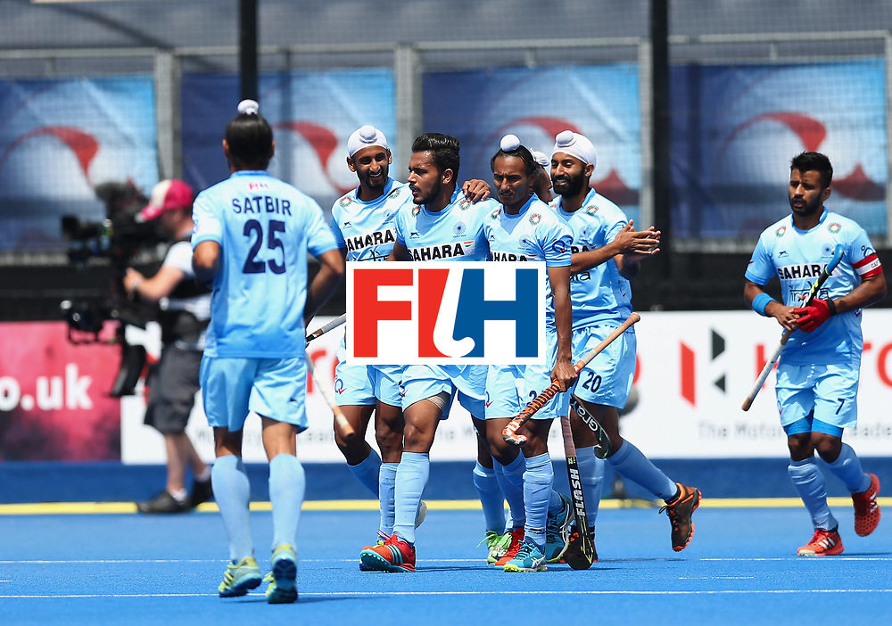 LONDON, ENGLAND - JUNE 25:  Harmanpreet Singh of India celebrates scoring their teams second goal with teammates during the 5th/6th place match between India and Canada on day nine of the Hero Hockey World League Semi-Final at Lee Valley Hockey and Tennis Centre on June 25, 2017 in London, England.  (Photo by Alex Morton/Getty Images)