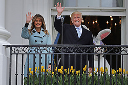 WASHINGTON, DC - APRIL 02: (AFP OUT) U.S. President Donald Trump (C) delivers remarks from the Truman Balcony with first lady Melania Trump during the 140th annual Easter Egg Roll on the South Lawn of the White House April 2, 2018 in Washington, DC. The White House said they are expecting 30,000 children and adults to participate in the annual tradition of rolling colored eggs down the White House lawn that was started by President Rutherford B. Hayes in 1878. (Photo by Chip Somodevilla/Getty Images)