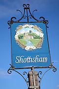 Village sign against blue sky, Shottisham, Suffolk, England picture suggestive of site factors