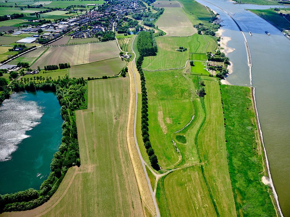 """Nederland, Gelderland, gemeenteWest Maas en Waal; 14–05-2020;  Waalbandijk ten oosten van Wamel (in het verschiet). Rechts van de verbrede dijk zijn populieren geplant. Water links 'De Wiel', rechts rivier De Waal. Rechtsboven langsdammen (vervangen de kribben).<br /> Waalbandijk east of Wamel. Poplars have been planted next to the widened dike. Water left """"De Wiel"""", right river De Waal. Upper right longitudinal dams (replace the groynes).<br /> <br /> luchtfoto (toeslag op standaard tarieven);<br /> aerial photo (additional fee required)<br /> copyright © 2020 foto/photo Siebe Swart"""