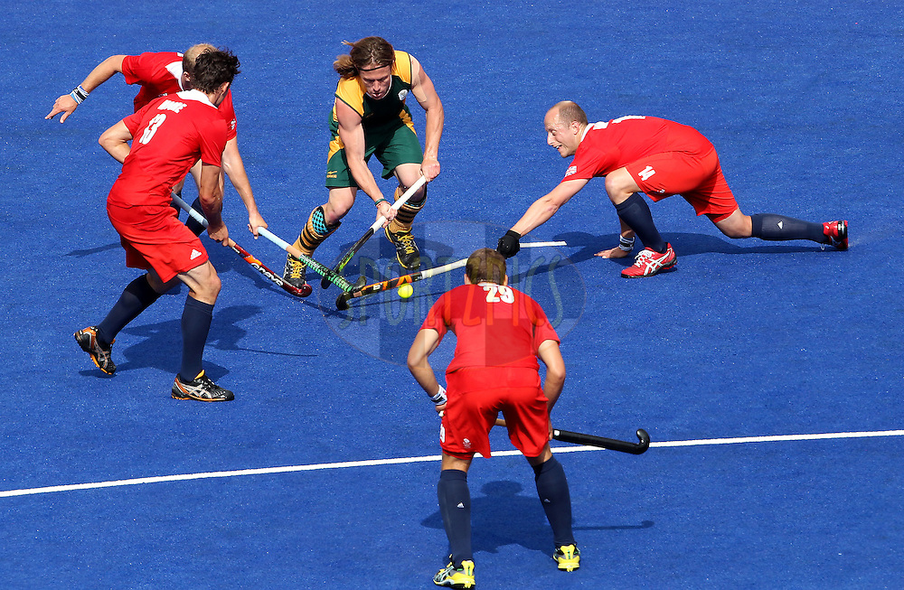 Jonathan Robinson of South Africa takes on the Great Britain defence during the men's hockey match between South Africa and Great Britain held at the Riverbank Arena at Olympic Park in London as part of the London 2012 Olympics on the 1st August 2012..Photo by Ron Gaunt/SPORTZPICS