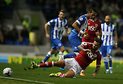 Bristol City midfielder Marlon Pack (21) slide tackles Brighton defender, full back, Liam Rosenior (23) during the Sky Bet Championship match between Brighton and Hove Albion and Bristol City at the American Express Community Stadium, Brighton and Hove, England on 20 October 2015.