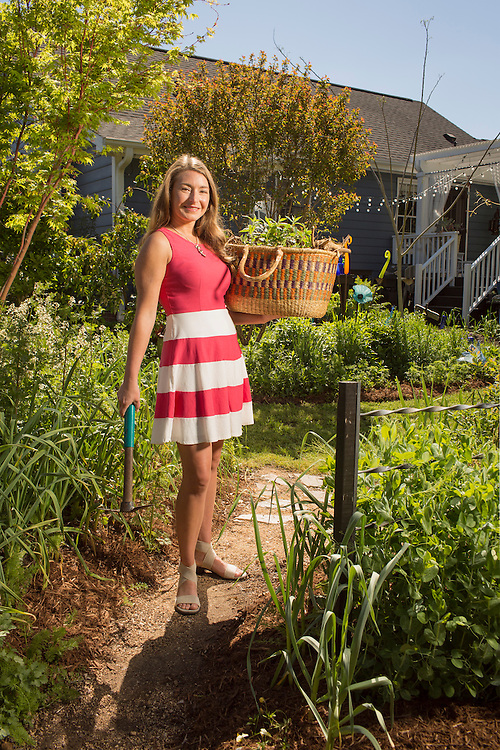 Brienne Gluvna is a leader in the foodscaping movement, emphasizing a balance of ornamentals and edibles for a visually appetizing result, pictured in her home garden in Fuquay-Varina, North Carolina, on Friday, April 8, 2016. <br /> Photo by D.L. Anderson for Ornamental Breeder Edibles: garlic, arugula<br /> Ornamentals:  acer palmatum 'sangu kaku' <br /> Prunus mume 'matsubara red' <br /> Magnolia 'donna'